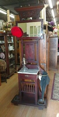 Antique mahogany umbrella stand, with marble top and beveled mirror