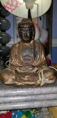Antique Chinese Bronz lotus Buddha in sitting position. Made in the orient