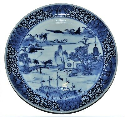 19th century Chinese blue and white plate, scene of village, farmer, river, cow.