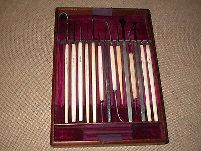 ANTIQUE MEDICAL OPHTHALMIC SURGICAL INSTRUMENTS in a fitted wooden tray