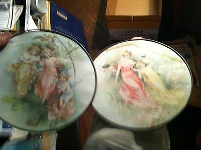 #12-37  pair of antique round tin rimmed angel prints under glass