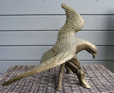 Vintage large brass cast American eagle with wings spread on perch