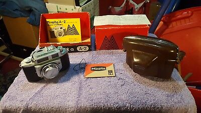 Minolta A-2 35 mm Camera in original box. Looks unused. 1958 with papers receipt