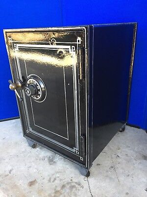 Antique floor safe with cast iron wheels