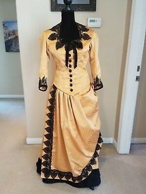 victorian bustle dress in a deep gold and black