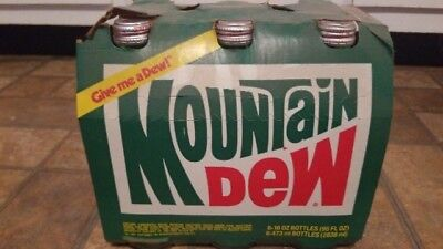 Vintage mountain dew glass bottles six pack Pepsi unopened in cardboard 1970's