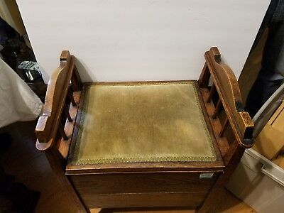 Antique single seat bench with armrests and storage.