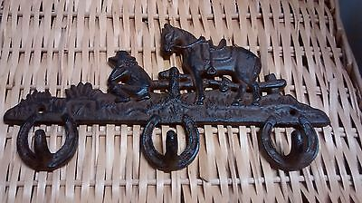 Cast Iron Cowboy resting his Horse with 3 hooks
