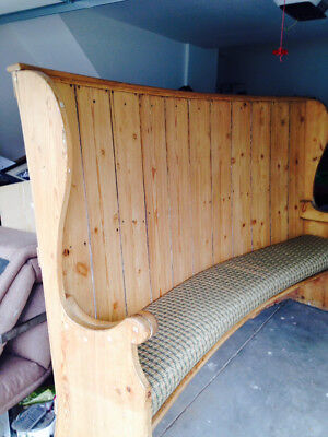 Wonderful large antique pine settle Lovely curved seat/back . cushioned seat.