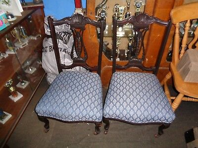 a pair of Edwardian nursing chairs with castor wheels. very good fabric