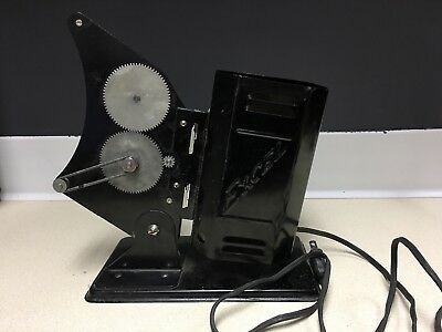 """Excel Projector - Vintage. black, hand crank. Roughly 10"""" tall."""