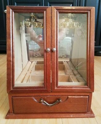 Vintage  wooden jewelry box with glass doors and spinner