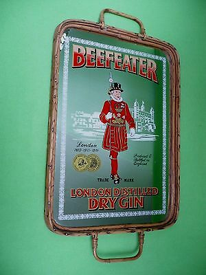 Vintage large mirrored BEEFEATER tray with bamboo/reed sides and wood bottom.VGC