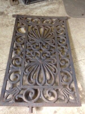 Coal delivery door grate 20th century junk 1930s ornate floral gothic cast iron
