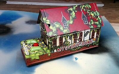tin toy Bank Very Rare Cragstan wind up Mystery bank in Original box 1957 works