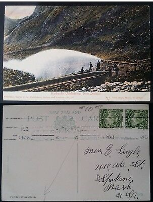 """1908 New Zealand Postcard """"Hydraulic Goldmining"""" ties 2 x 1/2 stamps to USA"""