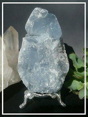 Celestite geode egg with silver stand.