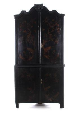 Continental Chinoiserie-decorated black lacquer corner cabinet Lot 1117A