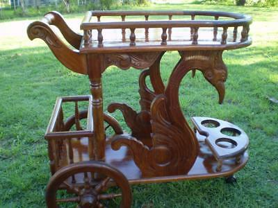 rustic bali timber drinks trolly carved features and swan on sides on wheels