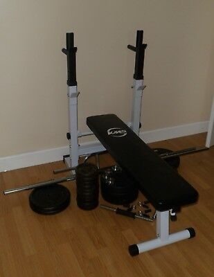 Weight Bench plus 94kgs of weights and selection of bars