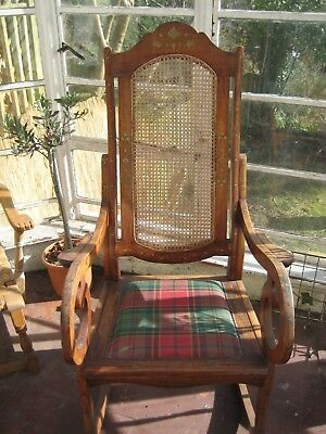 Rosewood Rocking chair inlaid with brass designs