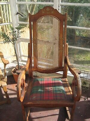 Rosewood Rocking chair with inlaid with brass designs