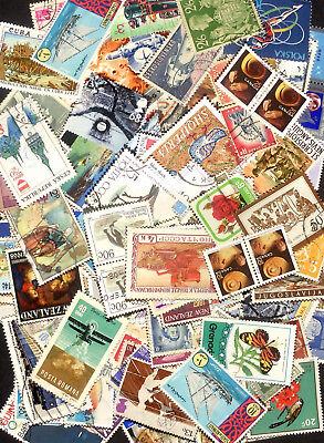 Over 35g of used World stamps - bulk off paper - hundreds