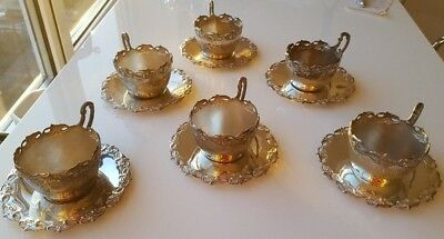 6 silverplated tea cup holders and saucers