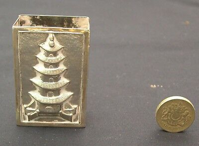 A Chinese silver match box cover embossed five-tier pagoda