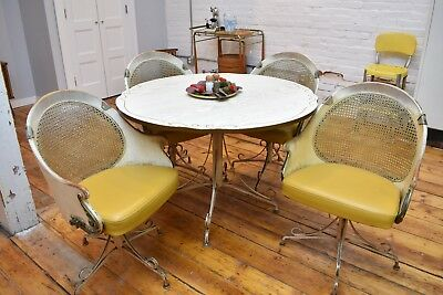 Mid Century Cast Iron Kitchen Table with Four Swivel Chairs