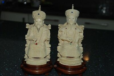 Pair of Chinese resin figures on wooden base. Very fine detail.