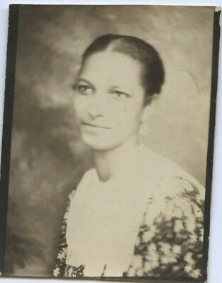 Vintage photo booth portrait.  DIGNIFIED YOUNG BLACK WOMAN.