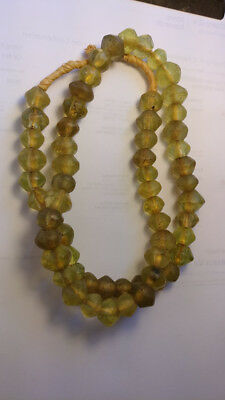 """24"""" strand of 60 antique tin-cut faceted Czech vaseline glass beads"""