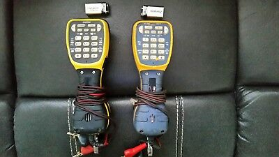 Two telephone test sets. One Fluke TS44 Pro and one Harris TS44 Deluxe Test Sets