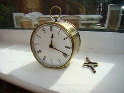 french 8 day brass drum clock in good working order with its double ended key