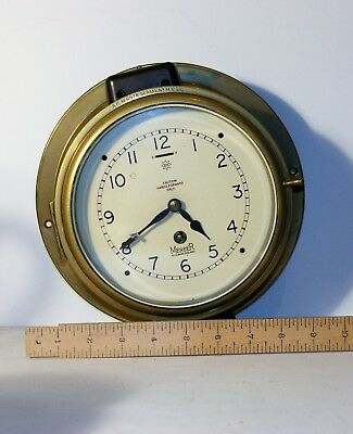Brass Ships clock by Mercer st Albans with key in working order, glass panel