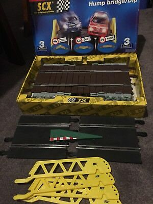 scx hump bridge / dip boxed spare track and boarder  looks new