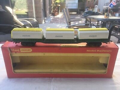 Triang/Hornby flat wagon with Chemical containers in OO scale.