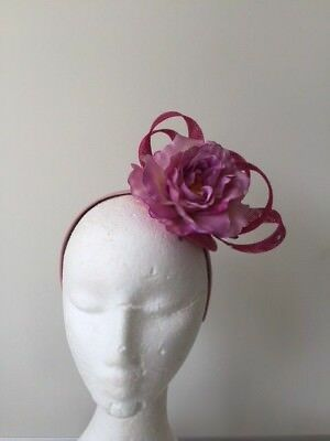 NEW design pink loop fascinator with a flower on a headband.