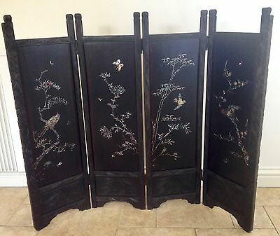 Japanese lacquered and mother of pearl inlaid four fold screen