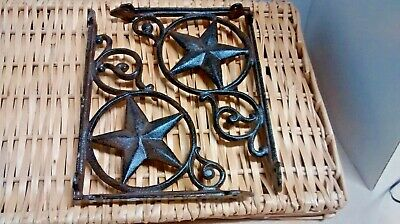 2 Cast Iron Shelf Brackets with a Large Star in a circle.