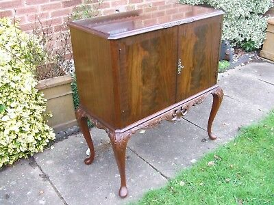 carved mahogany coctail cabinet