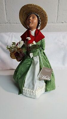 BYERS CHOICE  WILLIAMSBURG  CAROLER WOMAN HOLDING BASKET with FLOWERS. 2006