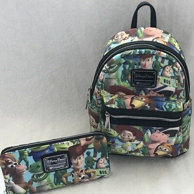 9f0cb1be6d5 Disney Parks Loungefly Toy Story Print Mini Backpack Bag   Wallet Set Woody  Buzz