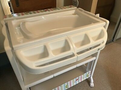 baby changing unit with bath.