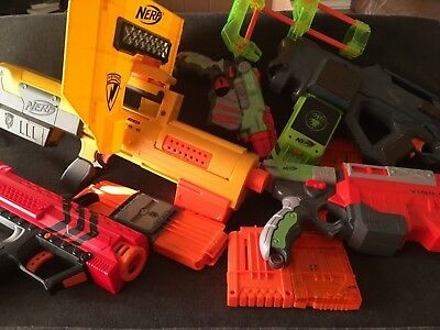 Nerf gun lot 5 used nerf guns, magazines, and a detachable stock.