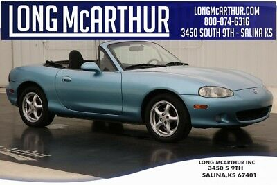 Mazda MX-5 Miata MX-5 BASE 1.8L 4 SPEED AUTOMATIC CONVERTIBLE SPORTS CAR FRONT BUCKET SEATS REAR GLASS WINDOW WITH DEFROST POWER DOORS AND WINDOWS