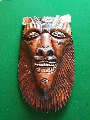 A stunning antique/vintage wooden carved mask/wall plaque