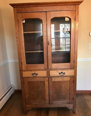 Antique Oak Larkin China Cabinet , glass doors,  drawers, and lower storage