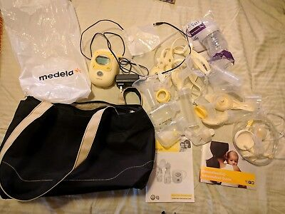 Medela Breast Pump Freestyle with bag and tons of accessories